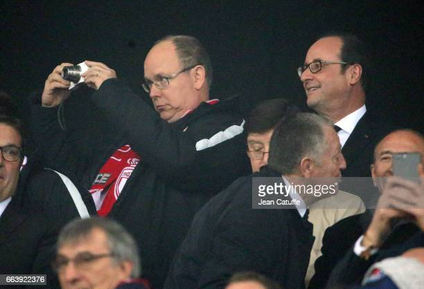 Prince Albert II of Monaco and French President Francois Hollande attend the French League Cup final between Paris SaintGermain and AS Monaco at Parc...