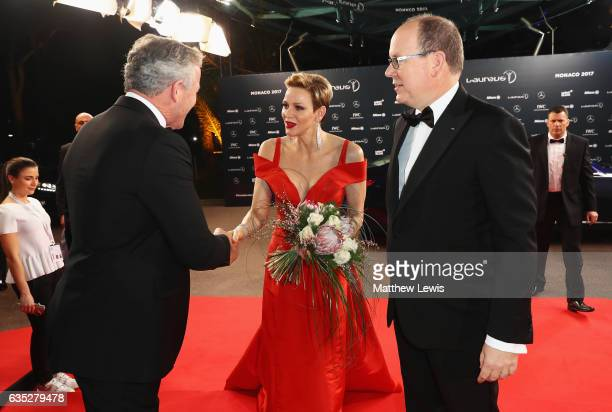 Prince Albert II of Monaco and his CharlenePrincess of Monaco are greeted at the red carpet by Laureus Academy Chairman Sean Fitzpatrick the 2017...