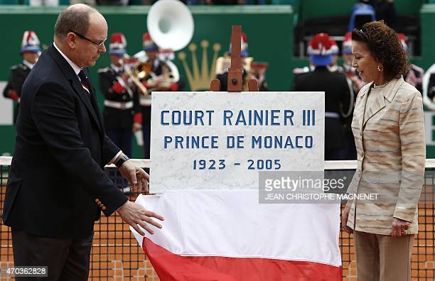 Prince Albert II of Monaco and his cousin ElisabethAnne de Massy unveils a plate reading Court Rainier III Prince of Monaco 19232005 as they...