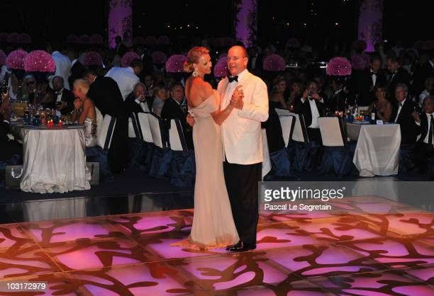 Prince Albert II of Monaco and his fiancee Charlene Wittstock dance during the 62nd Monaco Red Cross Ball at the Sporting Club Monte Carlo on July...