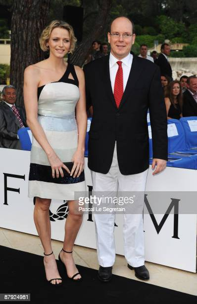 Prince Albert II of Monaco and his girlfriend Charlene Wittstock attend the Amber Fashion Show and Auction held at the Meridien Beach Plaza on May 22...