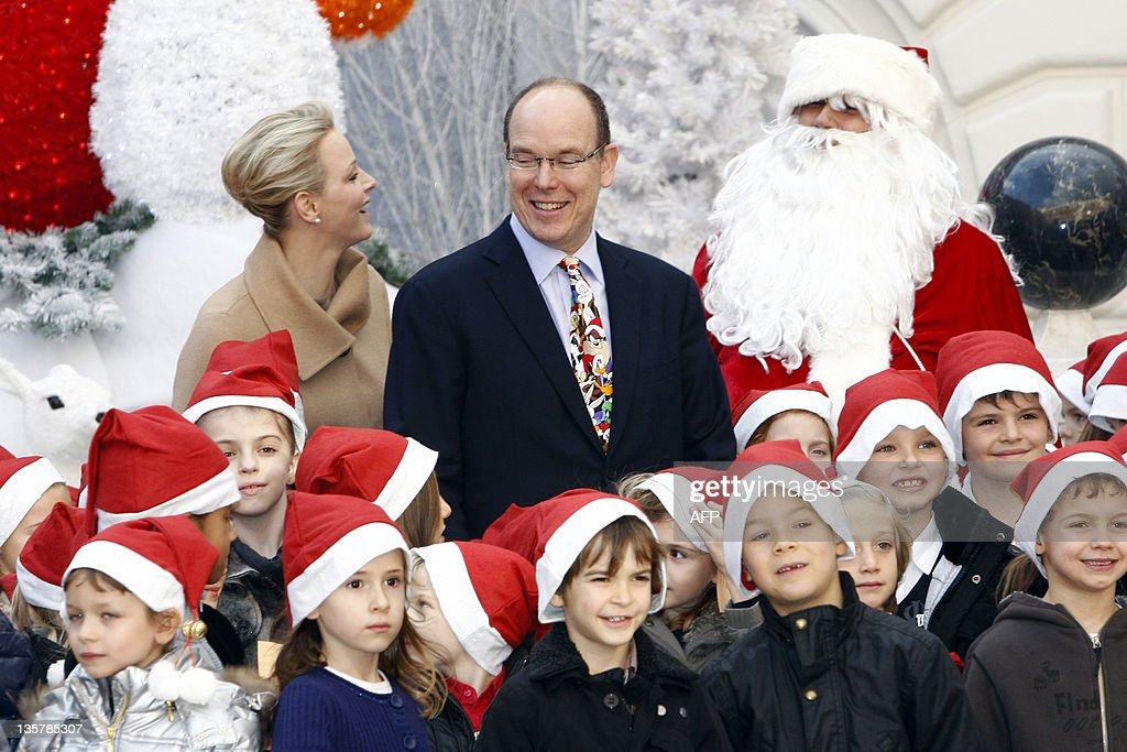 Prince Albert II of Monaco and his wife Charlene attend the Children's Christmas ceremony on December 15, 2011 at the Monaco Palace.