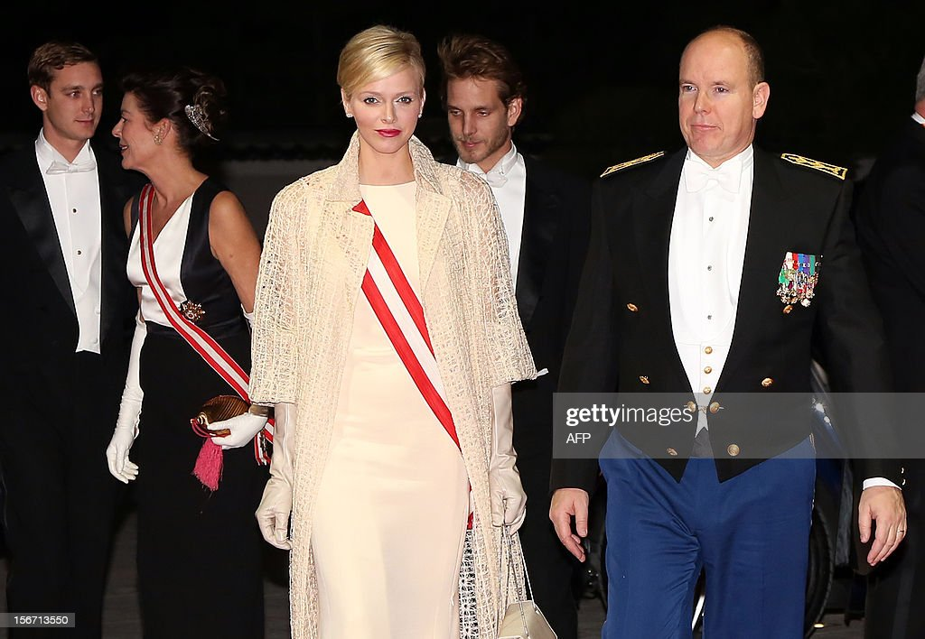 Prince Albert II of Monaco (R, foreground) and his wife Charlene of Monaco (C), followed by Princess Caroline of Hanover (2ndL, second ground) and his two sons, Pierre Casiraghi (L) and Andrea Casiraghi (C) arrive to attend the Monaco National Day gala evening at the Grimaldi Forum in Monte Carlo, on November 19, 2012.