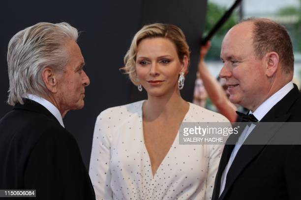 Prince Albert II of Monaco and his wife Charlene of Monaco welcome US actor Michael Douglas who'll receive a Golden Nymph Award for his career,...