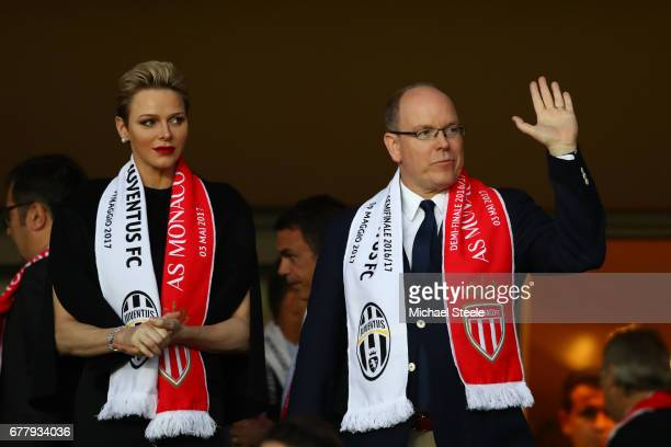 Prince Albert II of Monaco and his wife Charlene Princess of Monaco wave to supporters during the UEFA Champions League Semi Final first leg match...