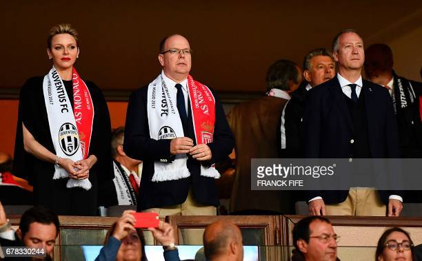Prince Albert II of Monaco and his wife Charlene, Princess of Monaco, and Monaco's Russian President Dmitriy Rybolovlev attend the UEFA Champions...