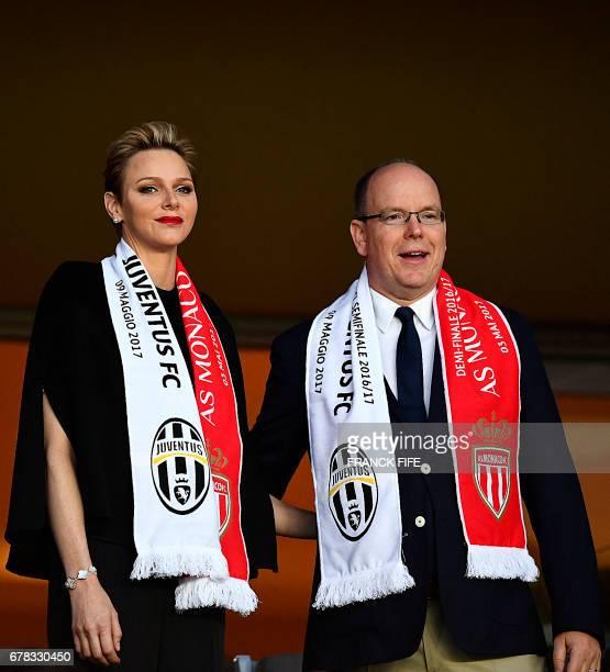 Prince Albert II of Monaco and his wife Charlene, Princess of Monaco, attend the UEFA Champions League semi-final first leg football match between...