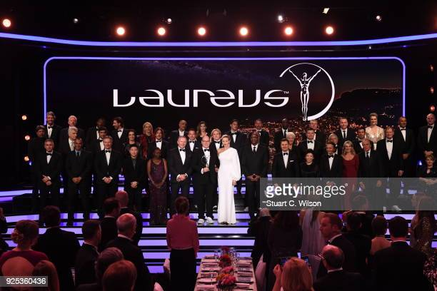 Prince Albert II of Monaco and his wife CharlenePrincess of Monaco on stage with the Academy Members during the 2018 Laureus World Sports Awards show...