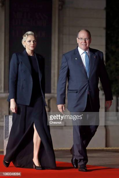 Prince Albert II of Monaco and his wife Princess Charlene arrive to attend a dinner hosted by French President Emmanuel Macron at the Orsay museum on...