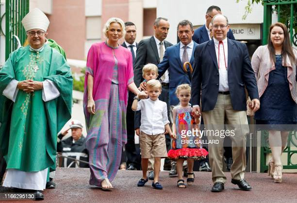 TOPSHOT Prince Albert II of Monaco and his wife Princess Charlene arrive with their twin children Prince Jacques and Princess Gabriella to take part...