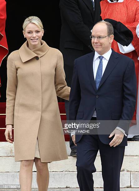 Prince Albert II of Monaco and his wife Princess Charlene leave the Monaco Cathedral during the SainteDevote festivities on January 27 in Monaco...