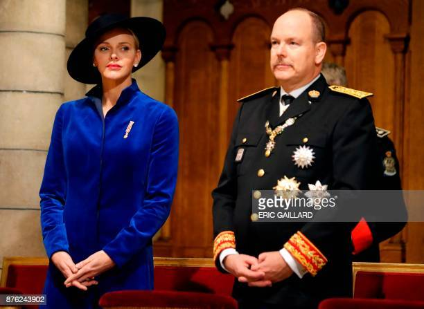 Prince Albert II of Monaco and his wife Princess Charlene of Monaco attend a mass at the Saint Nicholas cathedral during the celebrations marking...