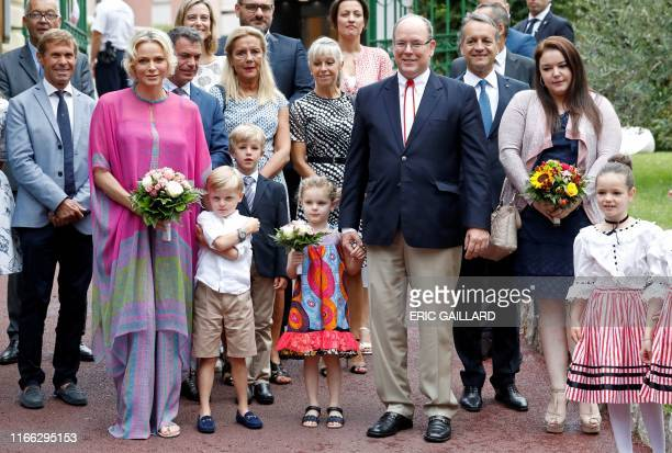 Prince Albert II of Monaco and his wife Princess Charlene pose for a picture as they arrive with their twin children Prince Jacques and Princess...