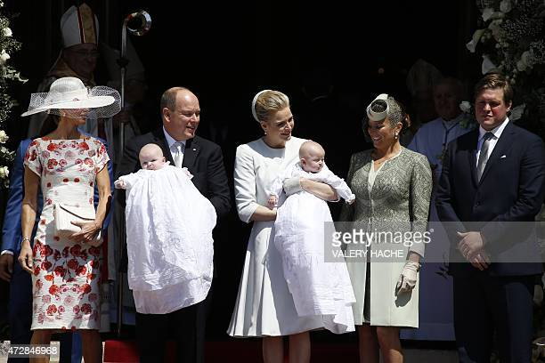 Prince Albert II of Monaco and his wife Princess Charlene pose outside the cathedral after the baptism of their twins Prince Jacques and Princess...