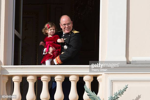 Prince Albert II of Monaco and India Casiraghi greet the crowd from the palace's balcony during the Monaco National Day Celebrationson November 19...
