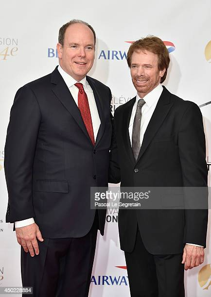 Prince Albert II of Monaco and Jerry Bruckheimer arrive at the opening ceremony of the 54th Monte-Carlo Television Festival on June 7, 2014 in...