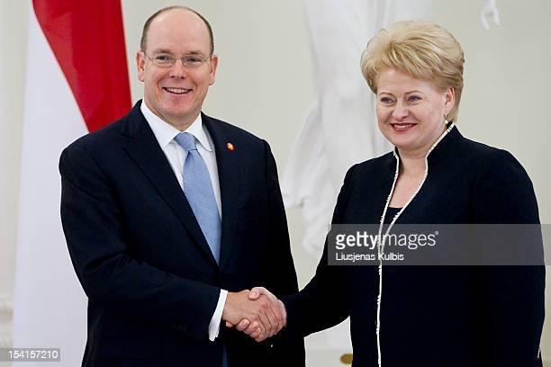 Prince Albert II of Monaco and Lithuania's President Dalia Grybauskaite shake hands during a meeting with Lithuanian President Dalia Grybauskaite,...