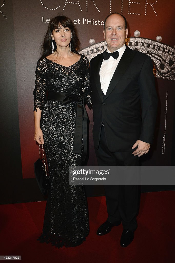 Prince Albert II of Monaco and Monica Bellucci arrive at the 'Cartier: Le Style et L'Histoire' Exhibition Private Opening at Le Grand Palais on December 2, 2013 in Paris, France.
