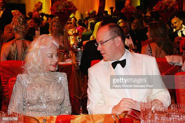Prince Albert II of Monaco and Ms Buzz Aldrin attend the 61st Monaco Red Cross Ball at the MonteCarlo Sporting Club on July 31 2009 in Monte Carlo...