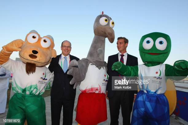 Prince Albert II of Monaco and Pierre Casiraghi pose with the Beach Asian Games' mascots during day 6 of the 2nd Asian Beach Games at AlMusannah...