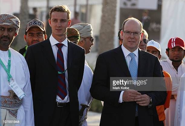 Prince Albert II of Monaco and Pierre Casiraghi watch local dancing during day 6 of the 2nd Asian Beach Games at AlMusannah Sports City on December...