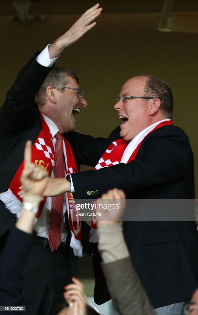 Prince Albert II of Monaco and President of AS Monaco Dmitri Rybolovlev (left) react at final whistle and celebrate winning the French Ligue 1 Championship title following the French Ligue 1 match between AS Monaco and AS Saint-Etienne (ASSE) at Stade Louis II on May 17, 2017 in Monaco, Monaco.