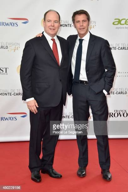 Prince Albert II of Monaco and Prince Emanuele Filiberto di Savoia arrive at the opening ceremony of the 54th Monte-Carlo Television Festival on June...