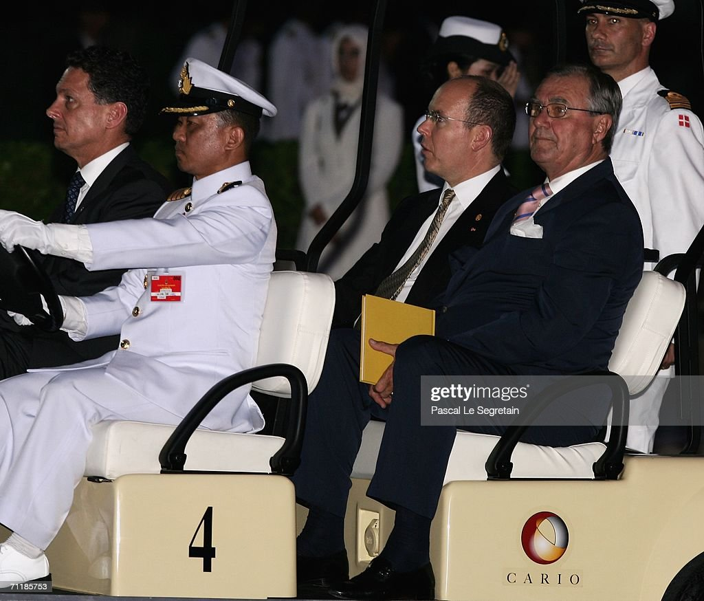 Prince Albert II of Monaco (2nd row L) and Prince Henrik of Denmark (R) arrives at the Royal Navy Club in a Golf Cart to attend the Royal Barge Procession on June 12, 2006 in Bangkok. The king of Thailand is marking the 60th anniversary of his accession to the throne.