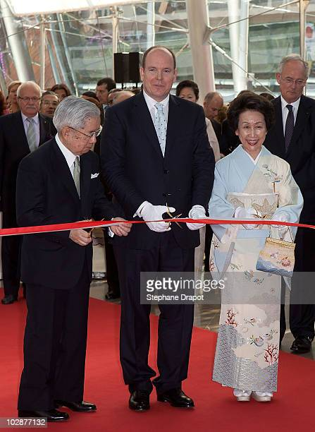 Prince Albert II of Monaco and Prince Hitachi of Japan with his wife Princess Hitachi of Japan cut the ribbon during the opening ceremony of the art...