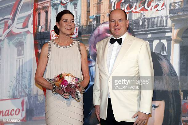 Prince Albert II of Monaco and Princess Caroline of Hanover arrive for the annual Rose Ball at the MonteCarlo Sporting Club in Monaco on March 19...