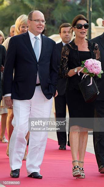 Prince Albert II of Monaco and Princess Caroline of Hanover attend the inauguration of the Buddha Bar on June 24 2010 in Monaco Monaco