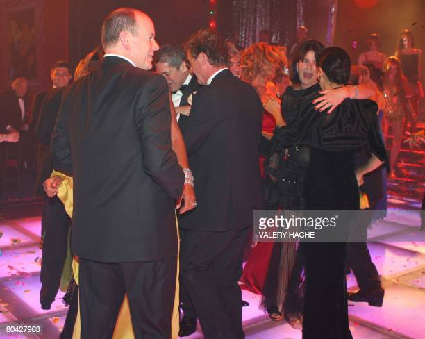 Prince Albert II of Monaco and Princess Caroline of Hanover dance during the annual Rose Ball at the Monte-Carlo Sporting Club in Monaco, 29 March...