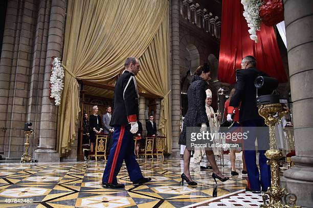 Prince Albert II Of Monaco and Princess Caroline of Hanover walk into the Monaco Cathedrale during the Monaco National Day Celebrations on November...
