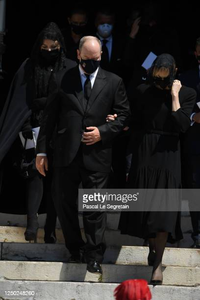Prince Albert II of Monaco and Princess Charlene of Monaco and Melanie Antoinette de Massy leave the Monaco Cathedral after ElizabethAnn De Massy's...