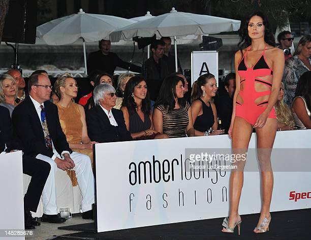 Prince Albert II of Monaco and Princess Charlene of Monaco and F1 Supremo Bernie Ecclestone and his fiancee Fabiana Flosi attend the Amber Fashion...