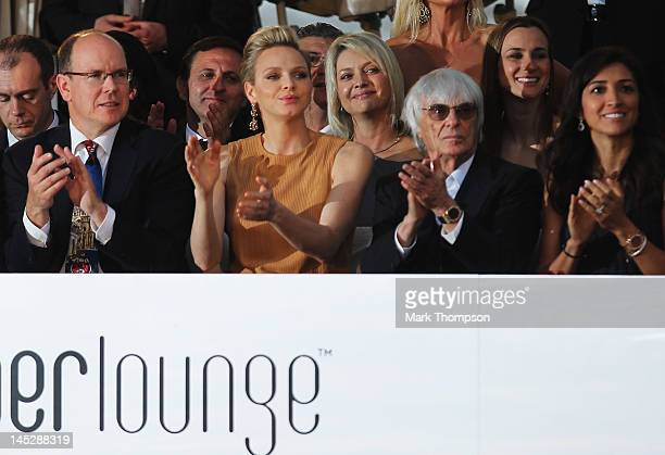 Prince Albert II of Monaco and Princess Charlene of Monaco and F1 Supremo Bernie Ecclestone and his fiancee Fabiana Flosi attend the Amber Fashion...