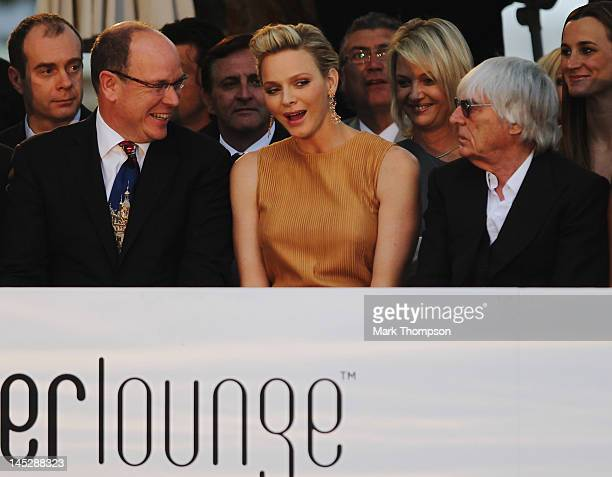 Prince Albert II of Monaco and Princess Charlene of Monaco and F1 Supremo Bernie Ecclestone attend the Amber Fashion Show and Charity Auction at Le...