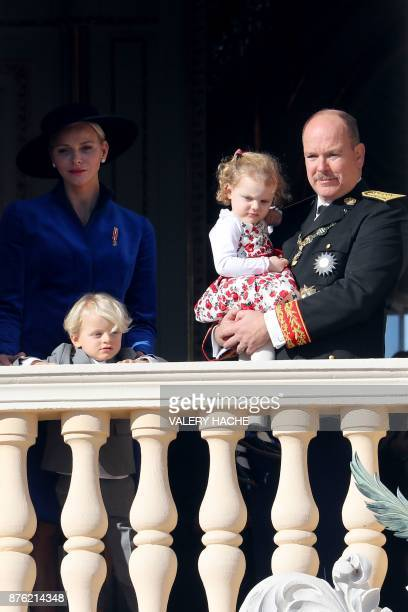 Prince Albert II of Monaco and Princess Charlene of Monaco appear with Prince Jacques and Princess Gabriella on the balcony of the Monaco Palace...