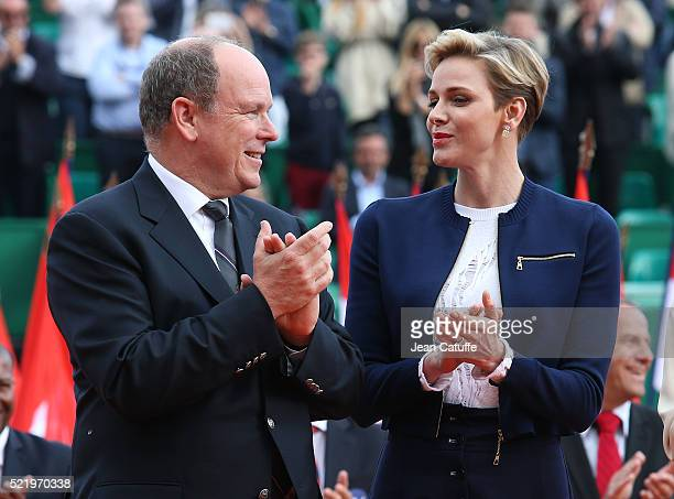 Prince Albert II of Monaco and Princess Charlene of Monaco applaud during the presentations after the singles final match between Rafael Nadal of...