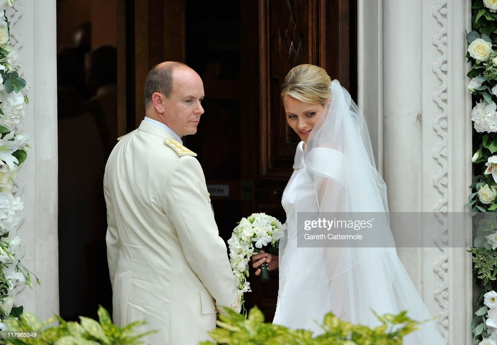 Prince Albert II of Monaco and Princess Charlene of Monaco arrive at Sainte Devote church after their religious wedding ceremony at the Prince's Palace of Monaco on July 2, 2011 in Monaco. The Roman-Catholic ceremony followed the civil wedding which was held in the Throne Room of the Prince's Palace of Monaco on July 1. With her marriage to the head of state of the Principality of Monaco, Charlene Wittstock has become Princess consort of Monaco and gains the title, Princess Charlene of Monaco. Celebrations including concerts and firework displays are being held across several days, attended by a guest list of global celebrities and heads of state.
