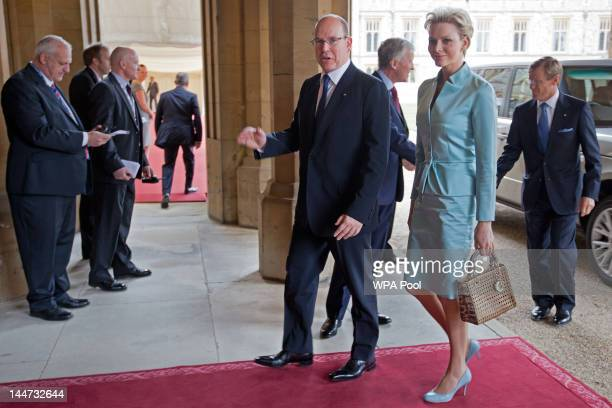 Prince Albert II of Monaco and Princess Charlene of Monaco arrive at a lunch For Sovereign Monarchs in honour of Queen Elizabeth II's Diamond Jubilee...