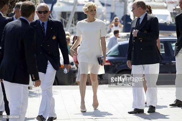 Prince Albert II of Monaco and Princess Charlene of Monaco arrive for the inauguration of new Yacht Club of Monaco on June 20 2014 in Monaco AFP...