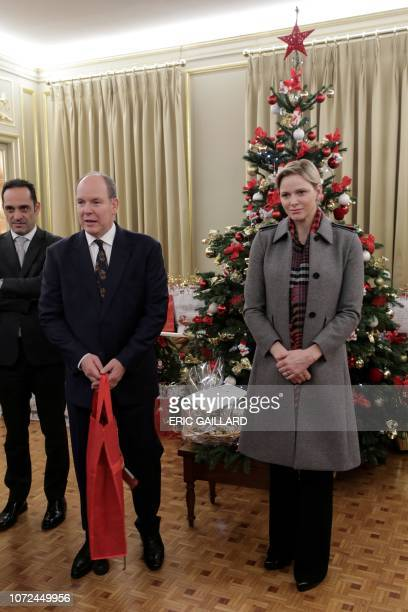 Prince Albert II of Monaco and Princess Charlene of Monaco attend a Christmas giftgiving event at the headquarters of the Red Cross in Monaco on...