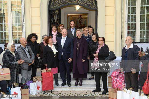 Prince Albert II of Monaco and Princess Charlene of Monaco attend Christmas gifts distribution at La Croix Rouge in Monte-Carlo on December 18, 2019...