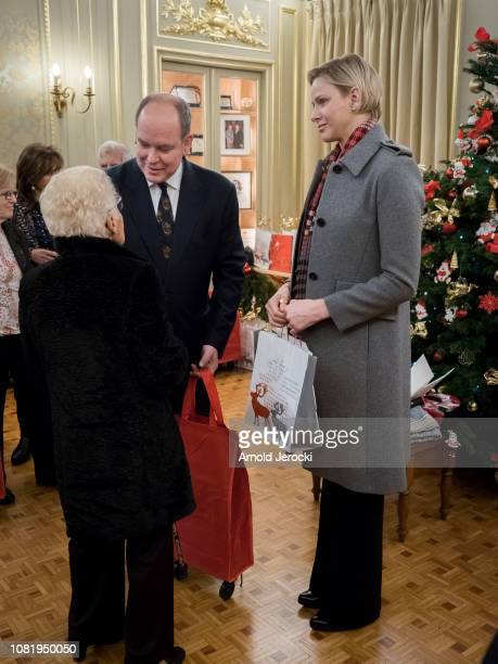 Prince Albert II of Monaco and Princess Charlene of Monaco attend the Christmas Gifts Distribution on December 13 2018 in MonteCarlo Monaco
