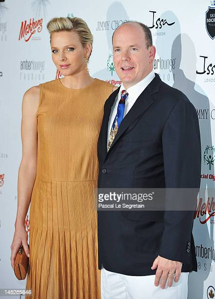 Prince Albert II of Monaco and Princess Charlene of Monaco attend the Amber Fashion Show and Charity Auction at Le Meridien Beach Plaza Hotel on May...