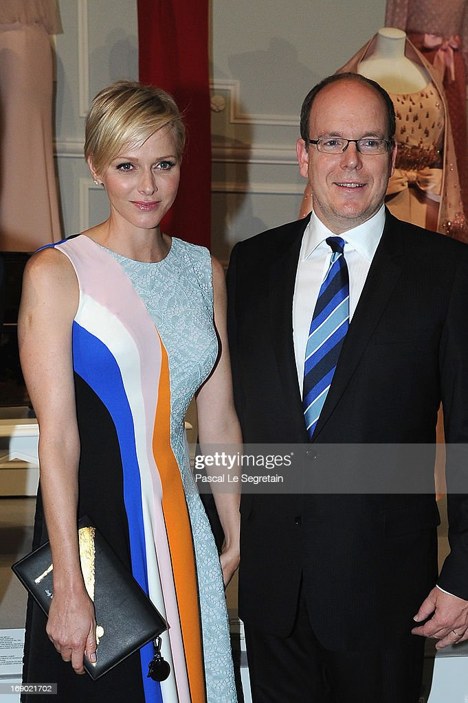 Prince Albert II of Monaco and Princess Charlene of Monaco attend the Dior Cruise Collection 2014 cocktail on May 18, 2013 in Monaco, Monaco.