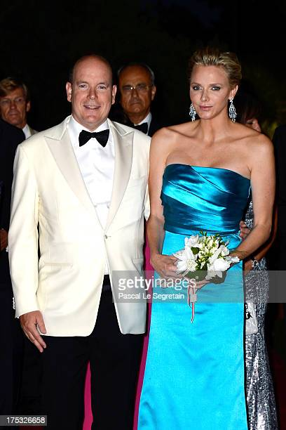 Prince Albert II of Monaco and Princess Charlene of Monaco attend the 65th Monaco Red Cross Ball Gala at Sporting MonteCarlo on August 2 2013 in...