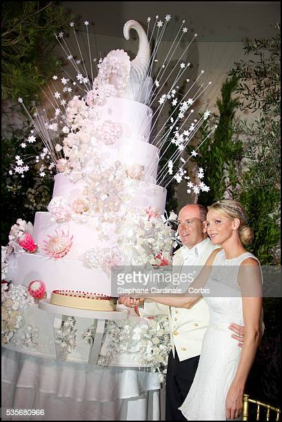 Prince Albert II of Monaco and Princess Charlene of Monaco cut the wedding cake during the dinner at Opera terraces after the religious wedding...