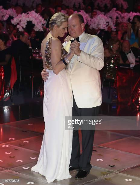 Prince Albert II of Monaco and Princess Charlene of Monaco dance during the 64th Red Cross Ball Gala in Salle des Etoiles at Sporting MonteCarlo on...